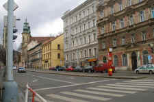 Turn to the right before the yellow house into the street Na Hrádku